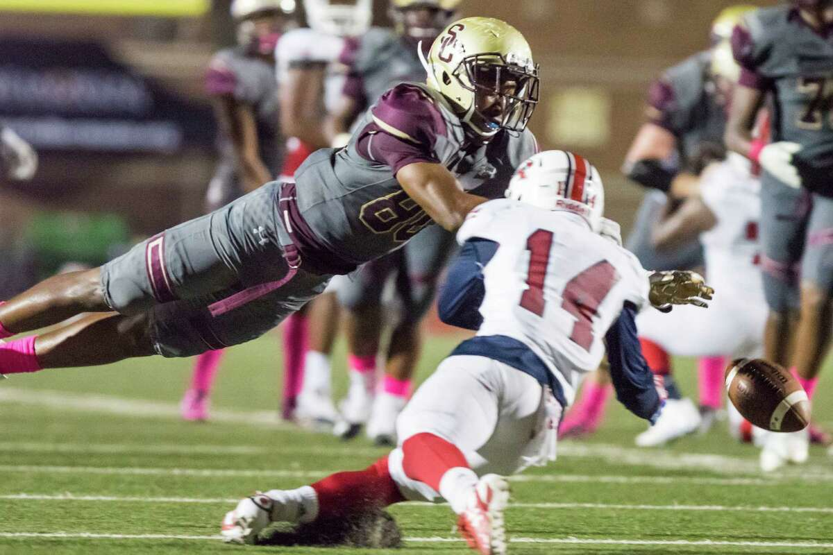 Summer Creek receiver Kenden Jones (80) dives for a pass that is knocked away by Atascocita defensive back Ray Bryan (14) in a high school football game at Turner Stadium on Friday, October 14, 2016, in Humble.