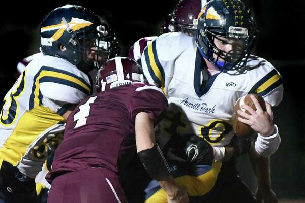 Averill Park's Carl Nitz, right, carries the ball during their football game against Lansingburgh on Friday, Oct. 14, 2016, at Lansingburgh High in Troy, N.Y. (Cindy Schultz / Times Union)