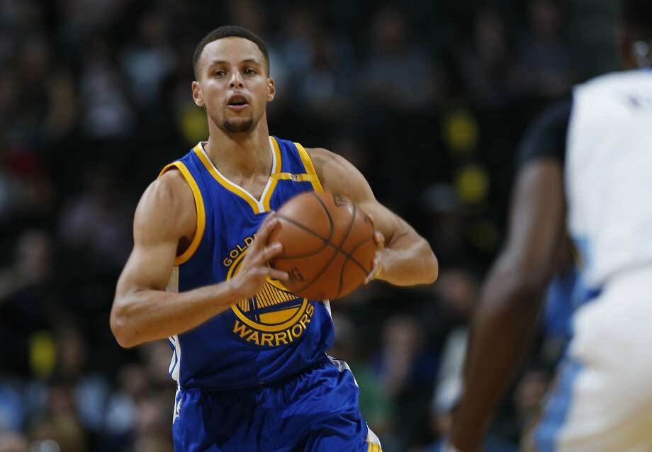 Golden State Warriors guard Stephen Curry passes the ball on a fast break against the Denver Nuggets in the first half of an NBA preseason basketball game Friday, Oct. 14, 2016, in Denver. (AP Photo/David Zalubowski) Photo: David Zalubowski, Associated Press