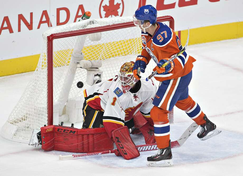 Edmonton's Connor McDavid slips a shot past Calgary goalie Brian Elliott in the second period. Photo: JASON FRANSON, Associated Press
