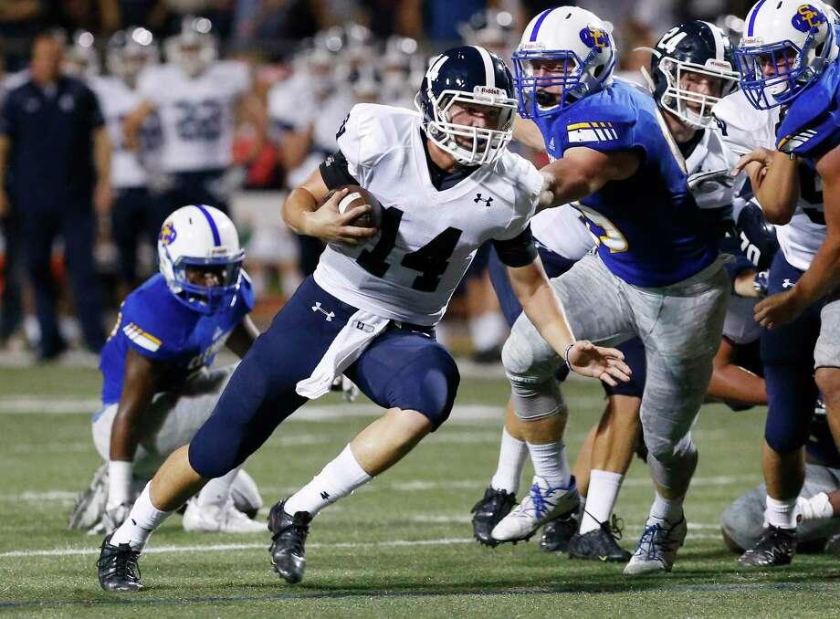 Smithson Valley's quarterback Josh Adkins runs on a keeper against Clemens at Lehnhoff Stadium on Oct. 14, 2016. Photo: Kin Man Hui /San Antonio Express-News / ©2016 San Antonio Express-News