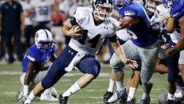 Smithson Valley quarterback Josh Adkins (14) runs on a keeper against Clemens at Lehnhoff Stadium on Oct. 14, 2016.