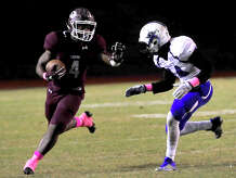 Silsbee's Calvin Tyler, Jr., looks to evade the pressure of Navasota's Da'Tron Taylor during Friday night's district match-up in Silsbee. Photo taken Friday, October 14, 2016 Kim Brent/The Enterprise