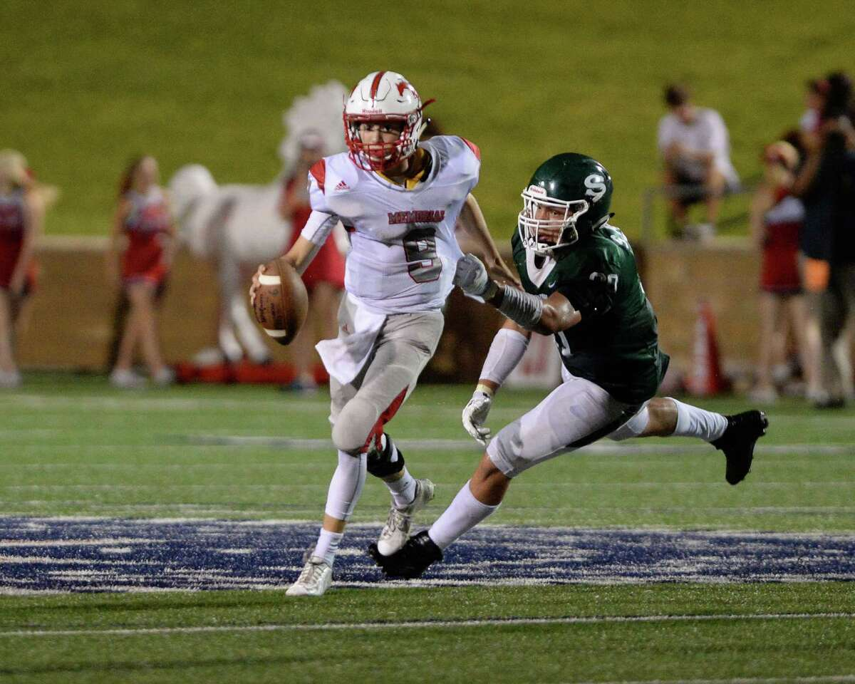 Quarterback Wilson Carrell (9) of Memorial is sacked by Stratford's Sam Miller (90) in the fourth quarter of a high school football game between the Memorial Mustangs and the Stratford Spartans on Friday October 14, 2016 at Tulley Stadium, Houston, TX.