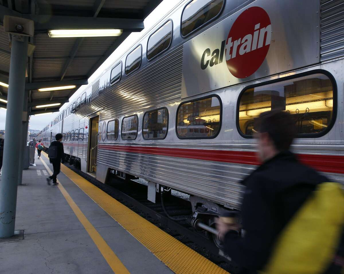 Commuters board a southbound train at the Caltrain Station at Fourth and Townsend streets in San Francisco, Calif. on Friday, Oct. 14, 2016.