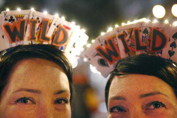 Lisa Thomas, 38, left, and Kristin Hembree, 38, pose for a portrait with their recent set of headbands before attending the Giants game against the Rockies Sept. 28, 2016 in San Francisco, Calif. The twins have been going almost monthly to Giants games since 2011 when their father helped to get them hooked on the sport. Over time, they began making matching headbands to wear and they now do it for every game they go to.
