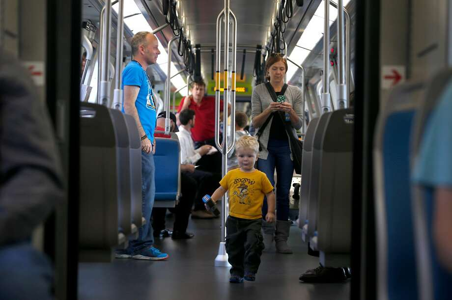 Harvey Pierce, 2, marches through the new BART cars during an open house tour at the Pleasant Hill Station. Photo: Paul Chinn, The Chronicle