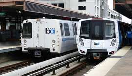 An San Francisco-bound train from BART's aging rolling stock pulls into the Pleasant Hill station alongside the next generation BART train which was open to the public in Pleasant Hill, Calif. on Saturday, Oct. 15, 2016.