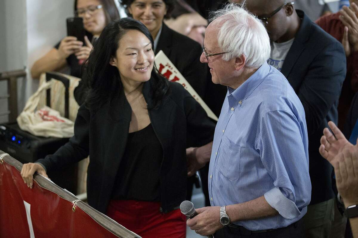 From right: Senator Bernie Sanders and Jane Kim embrace during a rally on Saturday, Oct. 15, 2016 in San Francisco, Calif. The rally was part of Kim's campaign for California State Senate, District 11.