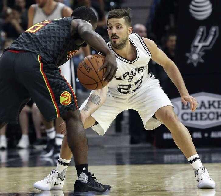 Nicolas Laprovittola guards in the front court as the Spurs host the Hawks in the home opener for the preseason on Oct. 8, 2016.