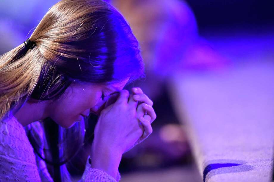 A worshiper prays at the altar during a service at River Point Community Church before baptisms in the Chattahoochee River, Sunday, Sept. 18, 2016, near Demorest, Ga. (AP Photo/Mike Stewart) Photo: Mike Stewart, STF / Copyright 2016 The Associated Press. All rights reserved.