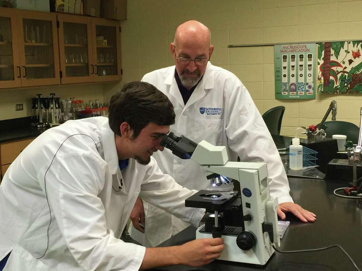 """Brian �""""Blake�"""" Maxfeldt, left, and Dr. Greg Frederick ofLeTourneauUniversity. Maxfeldt discovered the Solheim virus."""