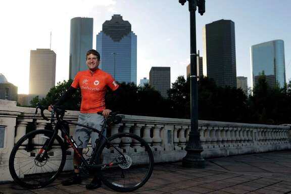 Coltivare Owner / Chef Ryan Pera poses for a portrait wearing his Chef's Cycle jersey on the Sabine Street bridge Oct. 12, 2016, in Houston. ( James Nielsen / Houston Chronicle )