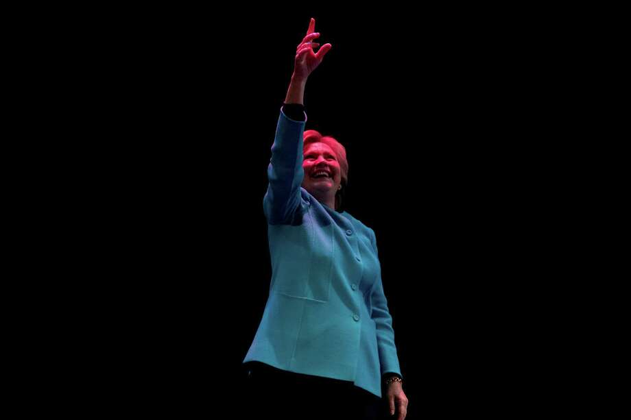 Democratic presidential candidate Hillary Clinton waves to the crowd after speaking at a fundraiser at the Paramount Theatre in Seattle, Friday, Oct. 14, 2016. Photo: Andrew Harnik, AP / Copyright 2016 The Associated Press. All rights reserved.