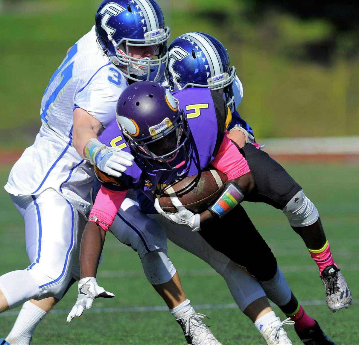 Westhill Tarik Rivers is stopped by Fairfield Ludlowe defenders in a FCIAC football game at Westhill High School in Stamford on Saturday, Oct. 15, 2016. Westhill defeated Fairfield Ludlowe 21-0.