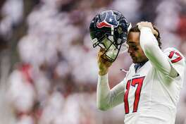 Houston Texans quarterback Brock Osweiler (17) recomposes himself after being sacked during the second half of an NFL football game at NRG Stadium Sunday, September 11, 2016 in Houston. ( Michael Ciaglo / Houston Chronicle )