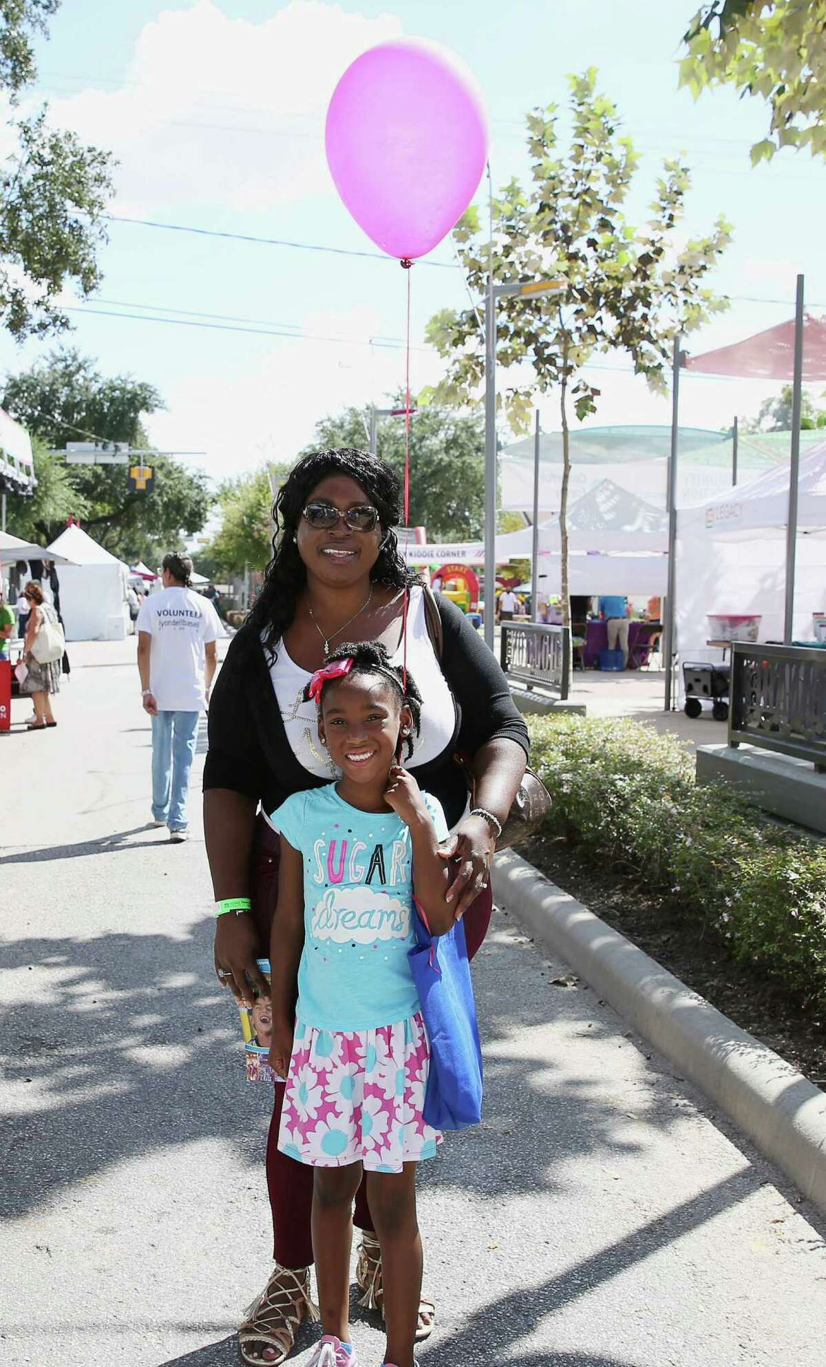 Festival goers pose for a photo at East End Street Festival Saturday, Oct. 15, 2016, in Houston. The festival was founded in 2011 to celebrate the legacy of Houston's historic East End.