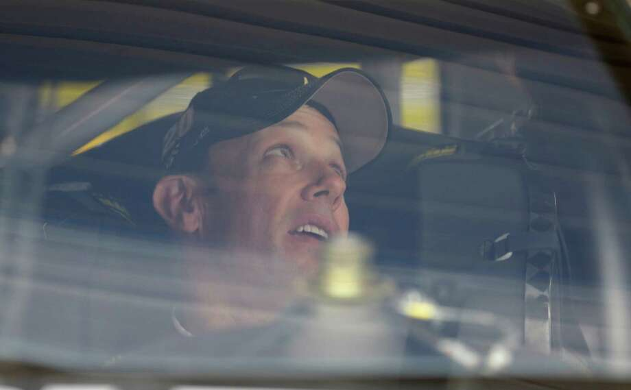 Driver Matt Kenseth sits in his car during practice for the NASCAR Sprint Cup Series auto race at Kansas Speedway in Kansas City, Kan., Saturday, Oct. 15, 2016.  (AP Photo/Colin E. Braley) Photo: Colin E. Braley, FRE / FR123678 AP