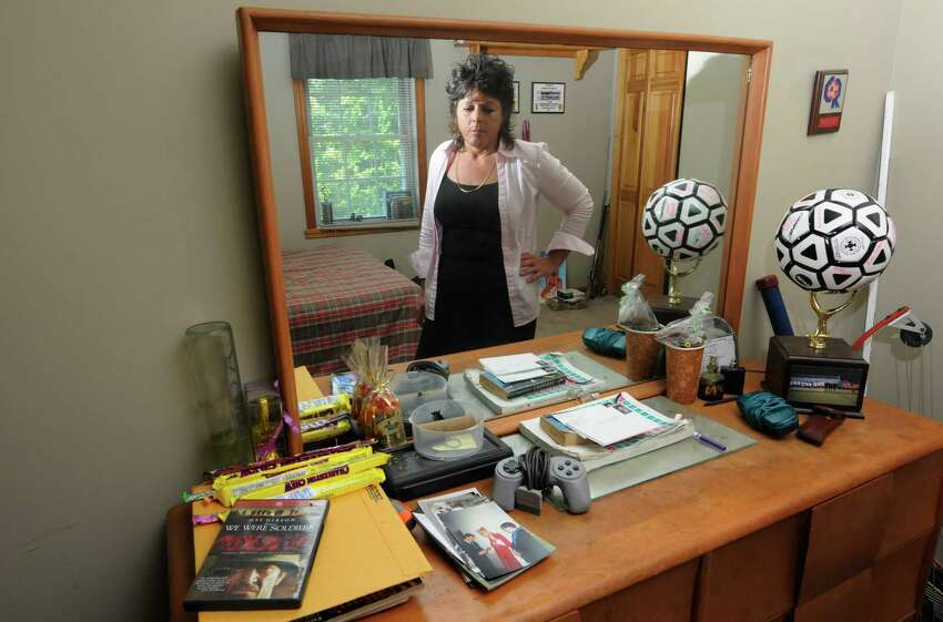 Veronica Frear , mother of a Craig Frear, a Scotia High School soccer player who disappeared seven years ago. stands in his room left undisturbed in the families home since his disappearance in Scotia , NY Tuesday Aug, 2, 2011.( Michael P. Farrell/Times Union)
