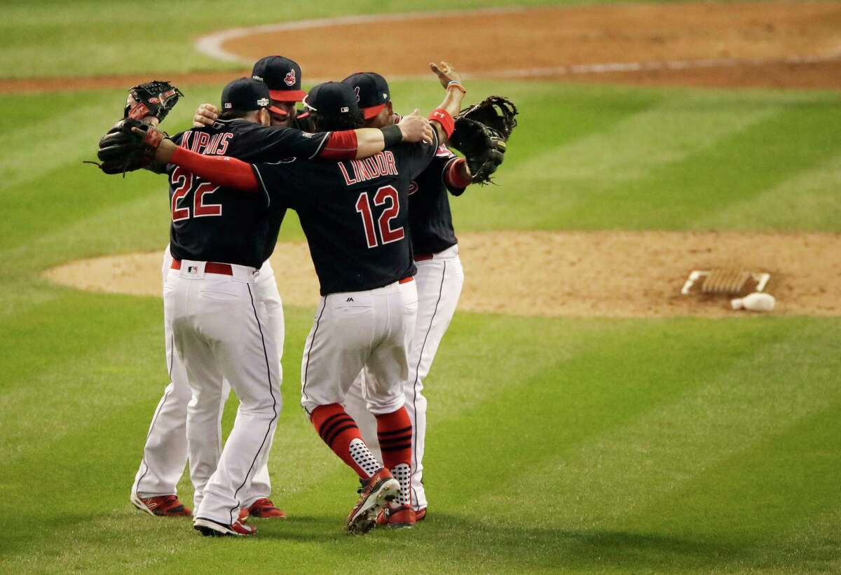Members of the Cleveland Indians celebrate after their 2-1 win against the Toronto Blue Jays in Game 2 of baseball's American League Championship Series in Cleveland, Saturday, Oct. 15, 2016. (AP Photo/Charlie Riedel)