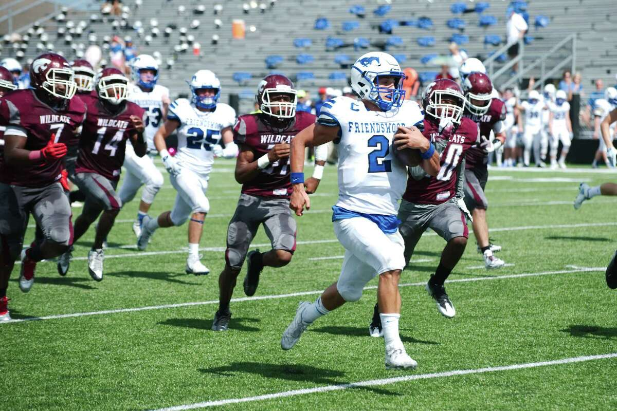 Friendswood quarterback Tyler Page outraces Clear Creek pursuit during the Mustangs' 52-34 victory in a District 24-6A football game Saturday. Page rushed 25 times for 387 yards and five touchdowns.