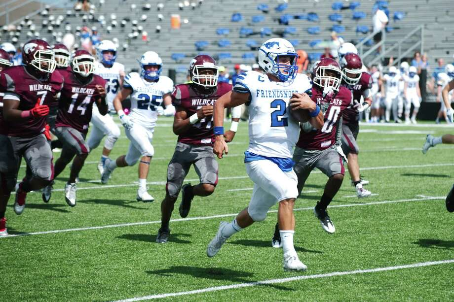 Friendswood quarterback Tyler Page outraces Clear Creek pursuit during the Mustangs' 52-34 victory in a District 24-6A football game Saturday. Page rushed 25 times for 387 yards and five touchdowns. Photo: Kirk Sides / © 2016 Kirk Sides / Houston Community Newspapers