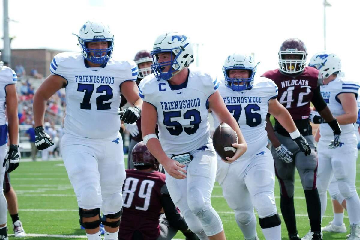Friendswood's Connor Stanford (53) celebrates after bulling his way into the end zone for a touchdown in the first half Saturday against Clear Creek.