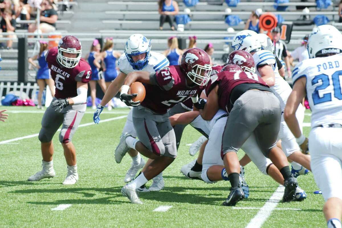 Clear Creek running back Noah Daniels (21) picks his way through the Friendswood defense Saturday afternoon in League City.
