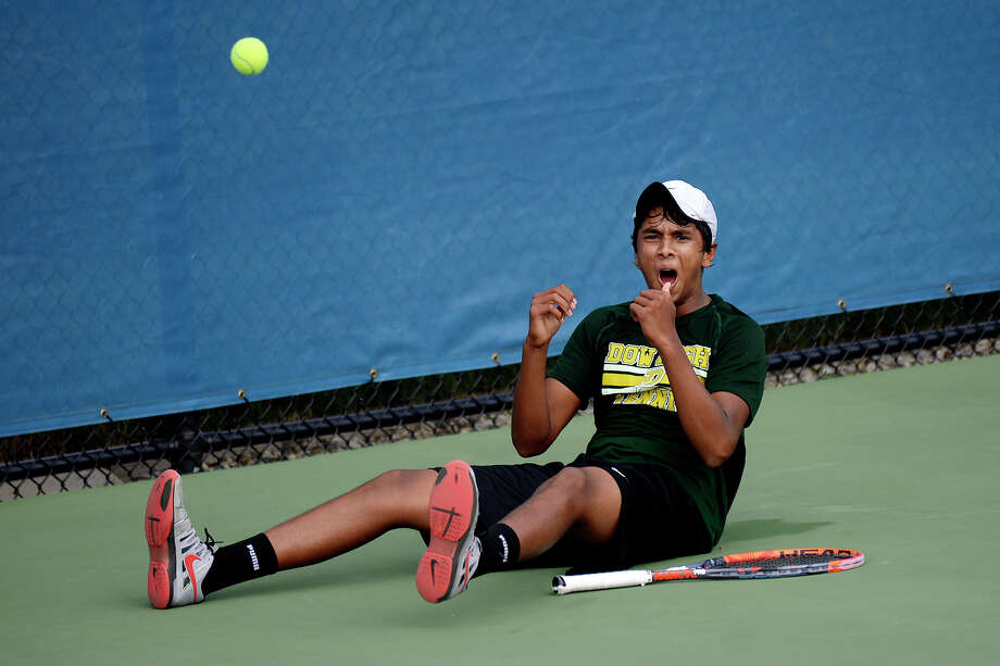 Dow's Varun Shanker celebrates his number one singles final match win over Kalamazoo Loy Norrix's Reed Crocker on Saturday at the DeWitt Tennis Center in Holland. Dow won the Division 2 state tennis title. Photo: NICK KING | Nking@mdn.net