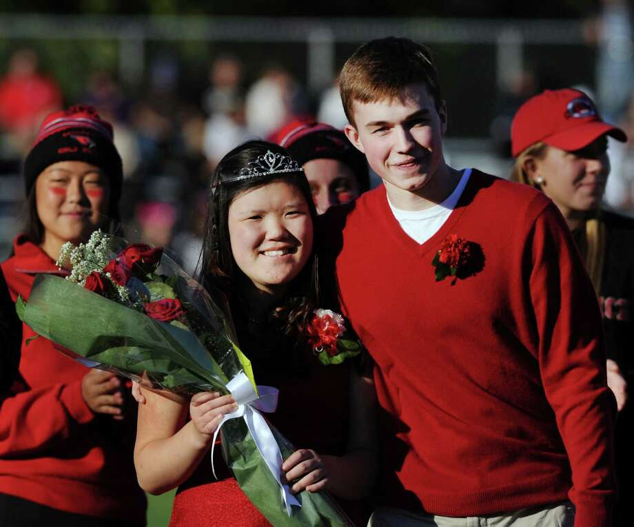 The Greenwich High School Homecoming Queen, Michelle Yoon, left, and the Homecoming King, Will DeTeso, during Homecoming activities at halftime of the GHS vs. Trumbull football game at Cardinal Stadium in Greenwich, Conn., Saturday, Oct. 15, 2016. Photo: Bob Luckey Jr. / Hearst Connecticut Media / Greenwich Time