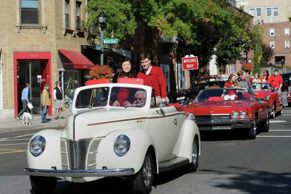 The Greenwich High School Homecoming Queen, Michelle Yoon, left, and the Homecoming King, Will DeTeso, right, rode in a convertible car during the Greenwich High School Homecoming Parade on Greenwich Avenue in Greenwich, Conn., Saturday, Oct. 15, 2016.