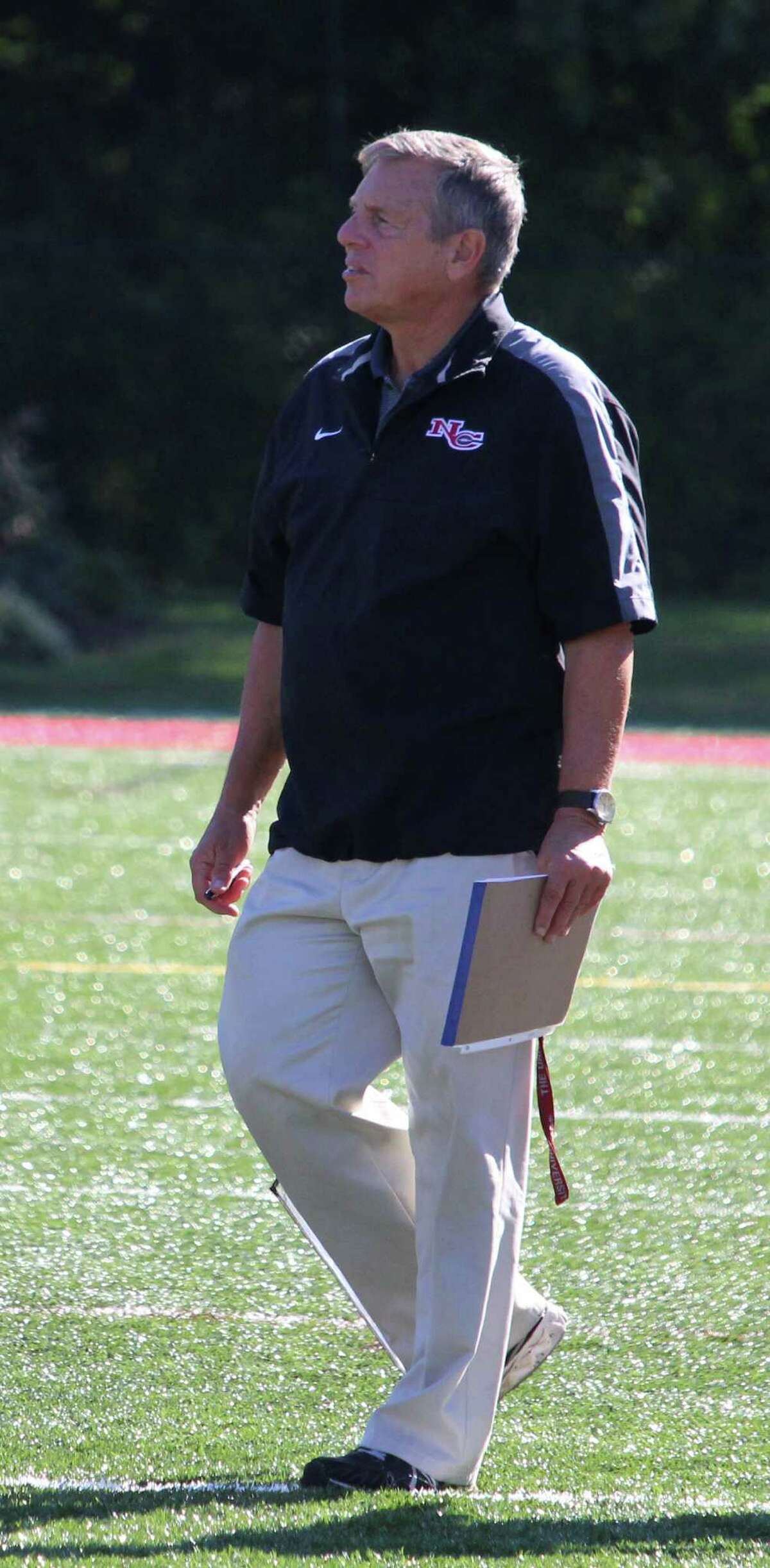 New Canaan coach Lou Marinelli stalks the sidelines during New Canaan's matchup with Danbury. The Rams defeated Danbury 37-14 Saturday, Oct. 15, 2016 at New Canaan High School in New Canaan, CT.