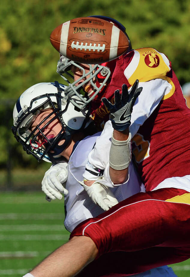 St. Joseph's High School player Nick Osboune and Wilton's Joseph Pozzi vie for the ball in their FCIAC football game Saturday, October 15, 2016 in Trumbull, Conn. Photo: Erik Trautmann / Hearst Connecticut Media / Connecticut Post