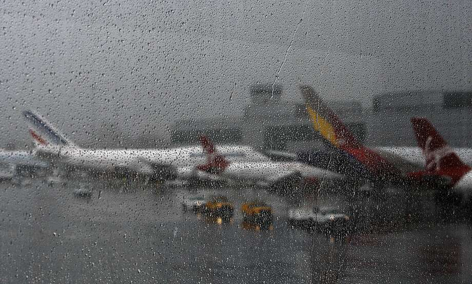 Hundreds of flights were delayed at SFO as the second San Francisco storm of the weekend moves in. Photo: Michael Macor, The Chronicle