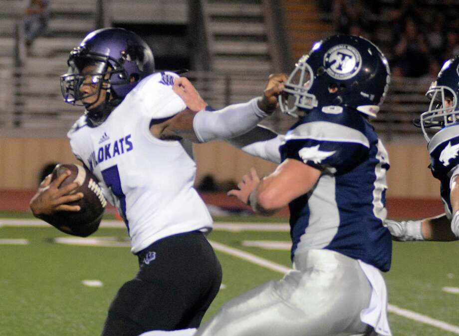 Willis' Taion Chatman stiff arms Tomball Memorial's Bryce Perkins during a long run at the Willis at Tomball Memorial football game on Friday night. Photo: David Hopper