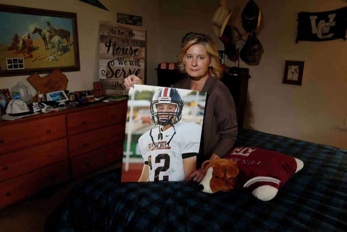 In August, Stacie Pollard (pictured) and her husband Dan lost their youngest son, Joshua, when he passed away due to sudden cardiac arrest from a previously undiagnosed heart condition. Pollard holds a picture of her 18-year-old son who played football and baseball at Churchill High School in his room. (Kin Man Hui/San Antonio Express-News)
