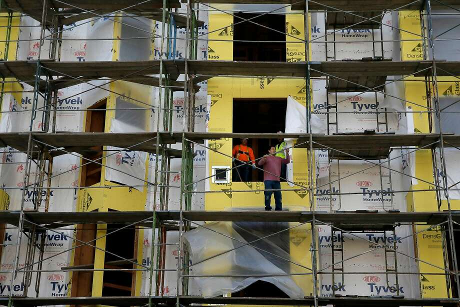 Housing construction at 1050 Valencia Street in San Francisco, Calif. on Wed. January 13, 2016. A new UC Berkeley poll found 51 percent of Bay Area voters had considered leaving due to housing costs. Photo: Michael Macor, The Chronicle