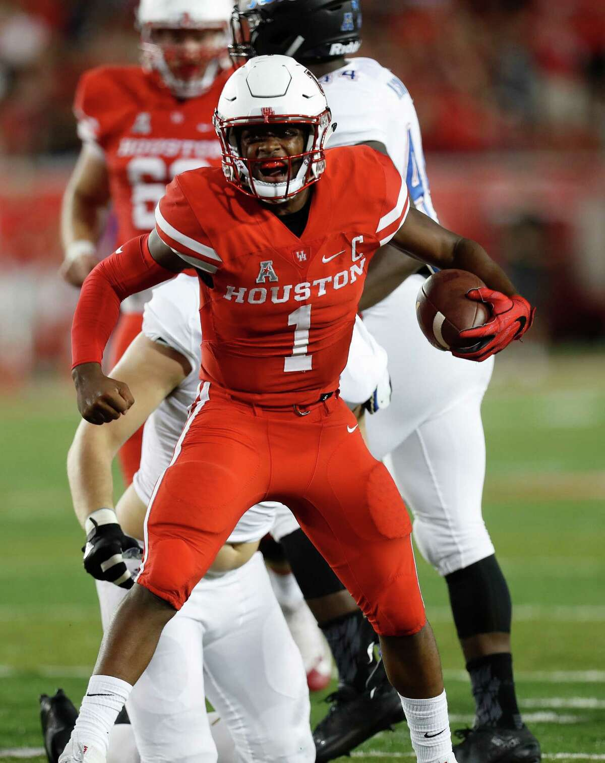 Houston Cougars quarterback Greg Ward Jr. (1) reacts after his long run gave the Cougars a first down during the second quarter of an NCAA college football game at TDECU Stadium, Saturday,Oct. 15, 2016 in Pearland.