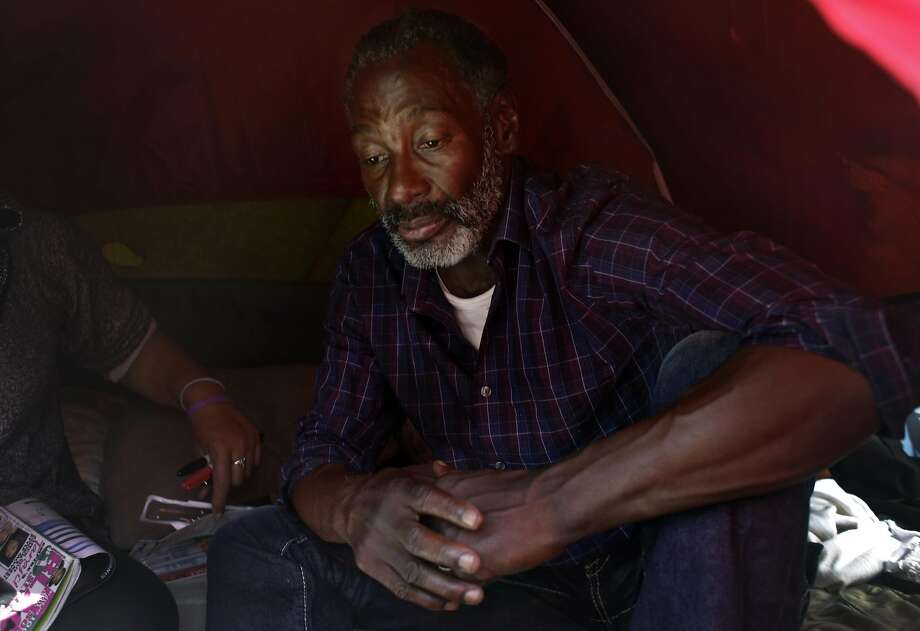 Steven Green (right) sits in a tent along Shotwell Street on Wednesday, September 28,  2016 in San Francisco,  California. Photo: Lea Suzuki, The Chronicle