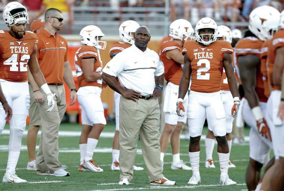 Longhorn coach Charlie Strong waits among his players for the start of the game as UT hosts Iowa State at DKR Stadium on October 15, 2016. Photo: TOM REEL, STAFF / SAN ANTONIO EXPRESS-NEWS / 2016 SAN ANTONIO EXPRESS-NEWS