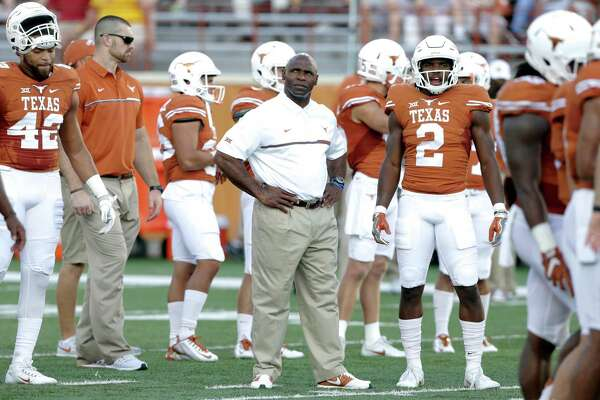 Longhorn coach Charlie Strong waits among his players for the start of the game as UT hosts Iowa State at DKR Stadium on October 15, 2016.