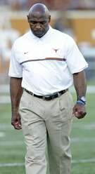 Texas coach Charlie Strong waits among his players for the start of the game against Iowa State at Royal-Memorial Stadium in Austin on Oct. 15, 2016.