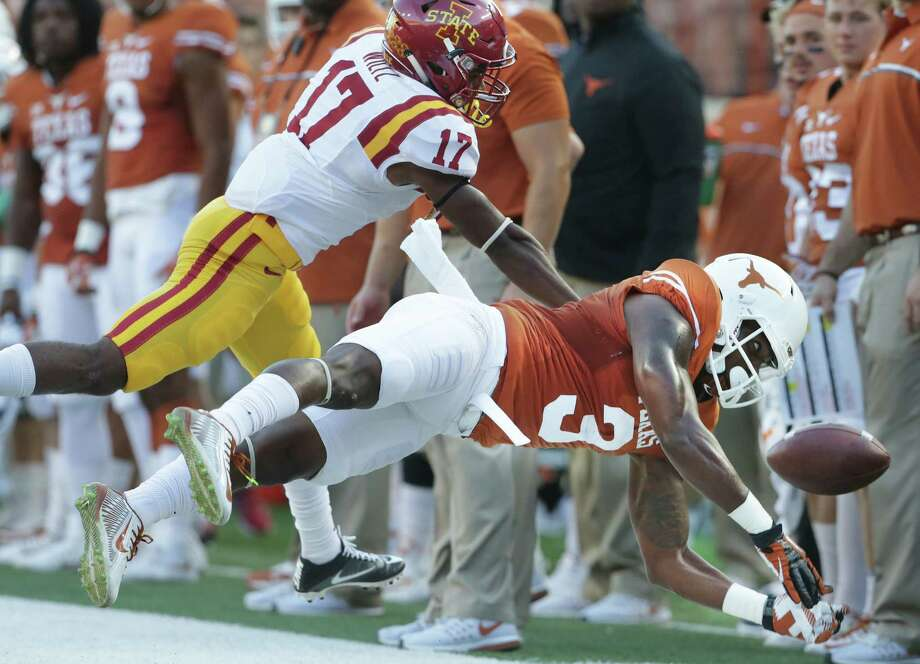 Longhorn wide receiver Armanti Foreman can't control the ball on a pass to the sideline under pressure from Lomal Wiltz as UT hosts Iowa State at DKR Stadium on October 15, 2016. Photo: TOM REEL, STAFF / SAN ANTONIO EXPRESS-NEWS / 2016 SAN ANTONIO EXPRESS-NEWS