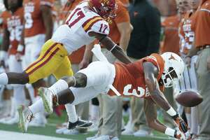 Longhorn wide receiver Armanti Foreman can't control the ball on a pass to the sideline under pressure from Lomal Wiltz as UT hosts Iowa State at DKR Stadium on October 15, 2016.