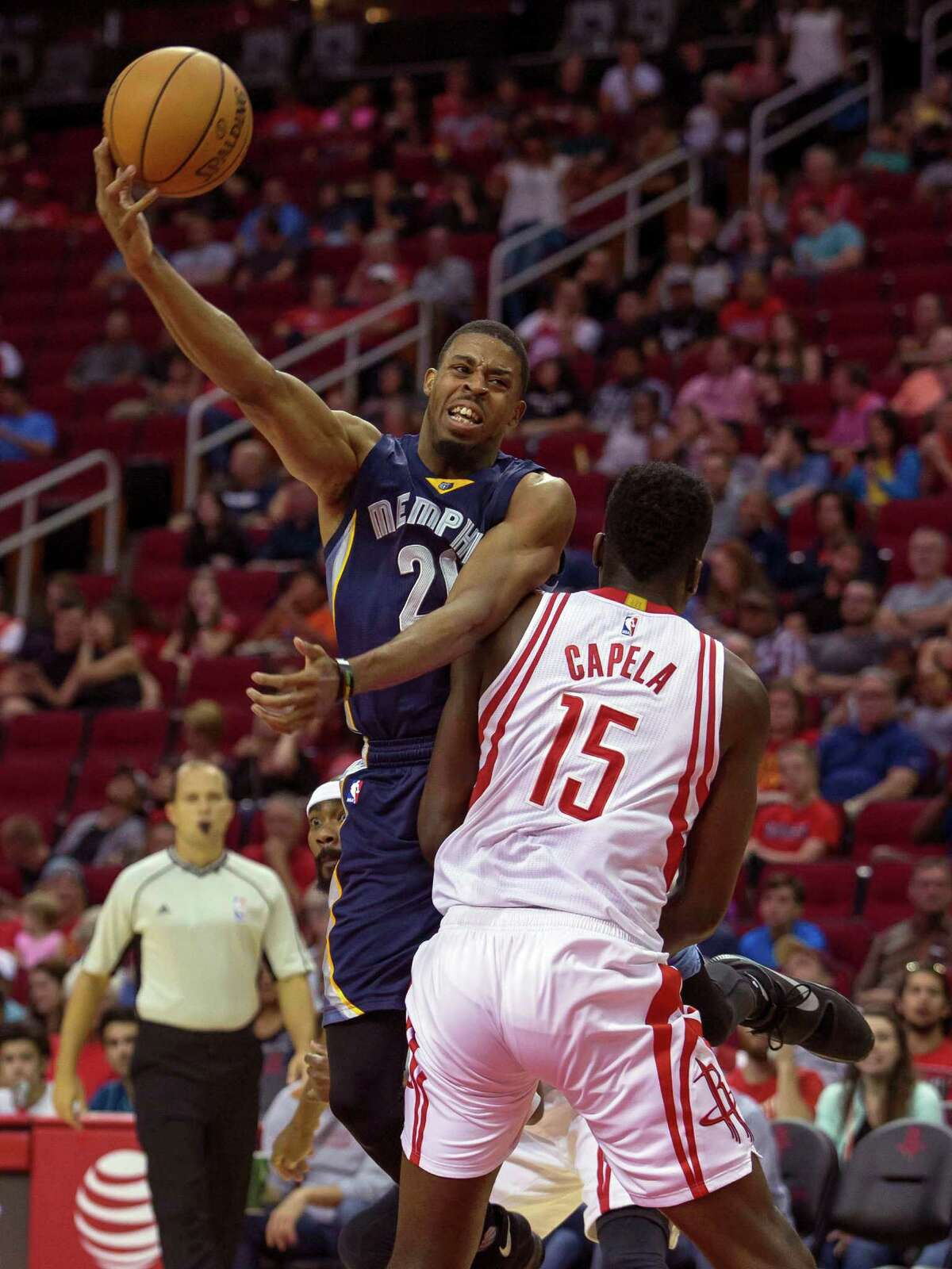 Memphis Grizzlies guard D.J. Stephens, top, shoots over Houston Rockets' Clint Capela in the first half of a preseason NBA basketball game Saturday, Oct. 15, 2016, in Houston. (AP Photo/Richard Carson)