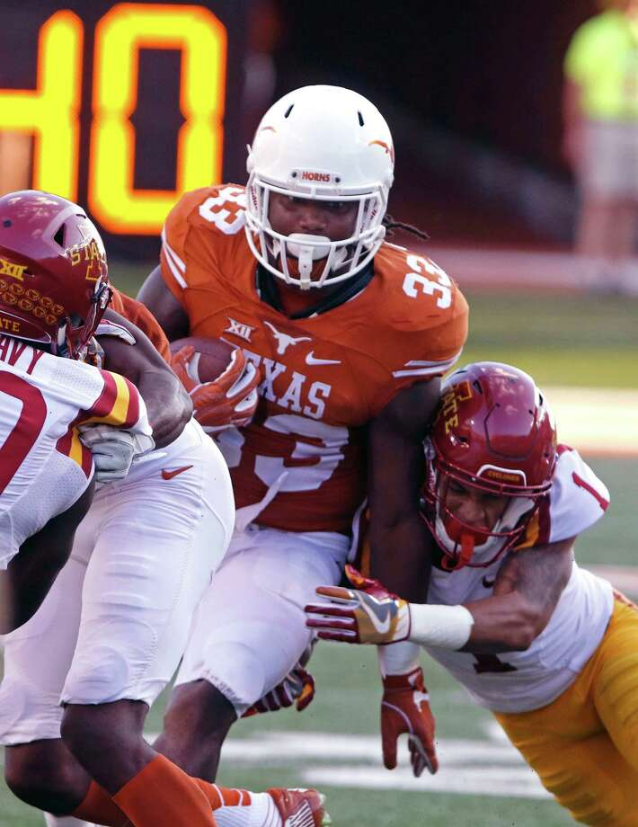 Texas running back D'Onta Foreman (33) runs the ball against Iowa State defensive back D'Andre Payne (1) during the first half of an NCAA college football game, Saturday, Oct. 15, 2016, in Austin, Texas. (AP Photo/Michael Thomas) Photo: Michael Thomas, FRE / FR65778 AP