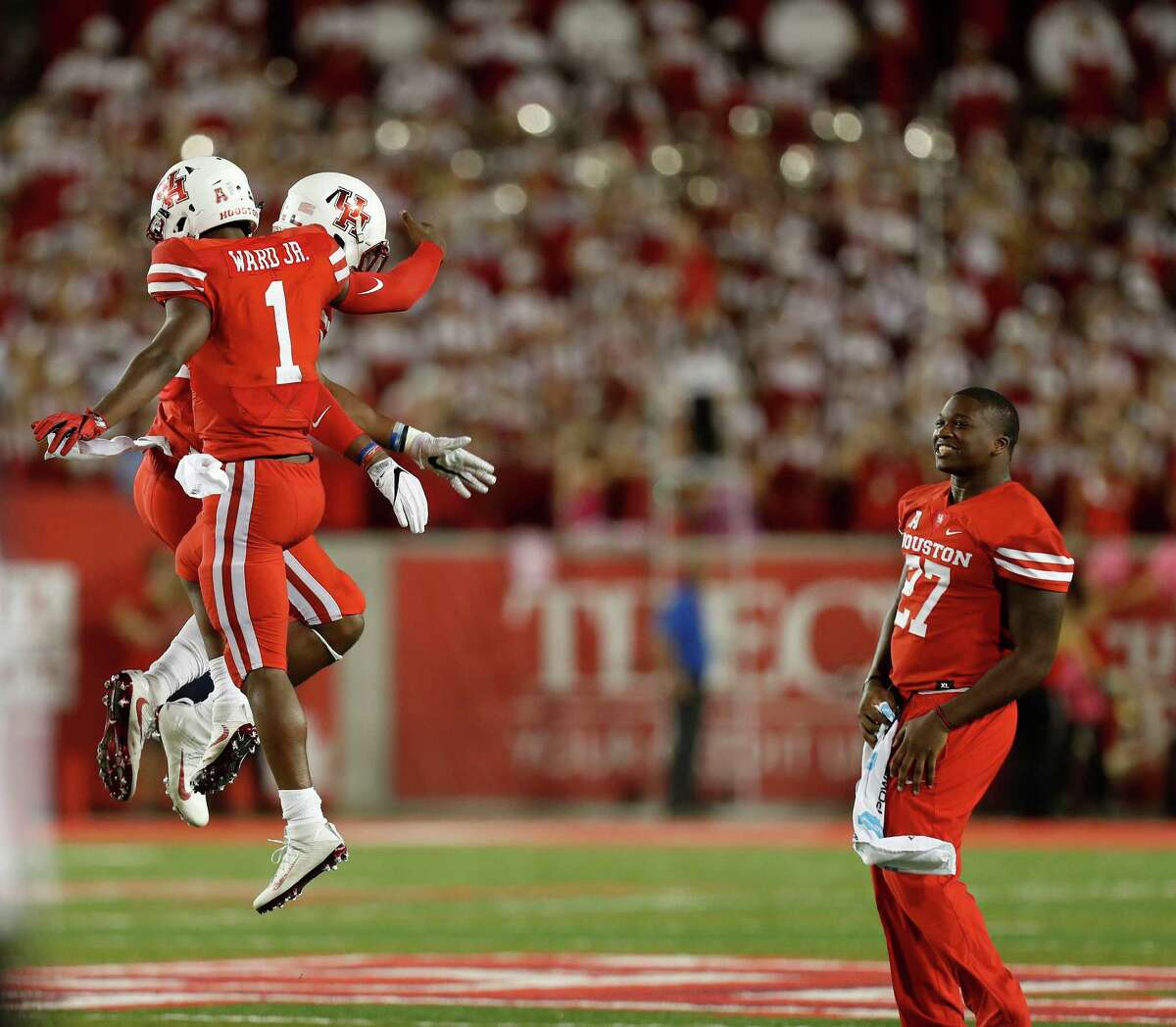Houston Cougars safety Austin Robinson (22) and quarterback Greg Ward Jr. (1) celebrate after Robinson stopped Tulsa Golden Hurricane defensive tackle Jesse Brubaker (8) at the goal line in the final seconds of a tied game during the second half of an NCAA college football game at TDECU Stadium, Saturday,Oct. 15, 2016 in Pearland.