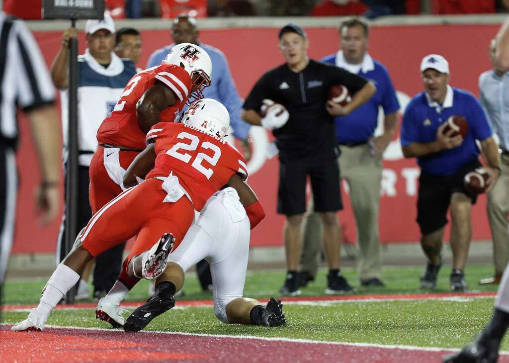 Houston Cougars safety Austin Robinson (22) stops Tulsa Golden Hurricane defensive tackle Jesse Brubaker (8) at the goal line in the final seconds of a tied game during the second half of an NCAA college football game at TDECU Stadium, Saturday, Oct. 15, 2016. Photo: Karen Warren, Houston Chronicle / 2016 Houston Chronicle
