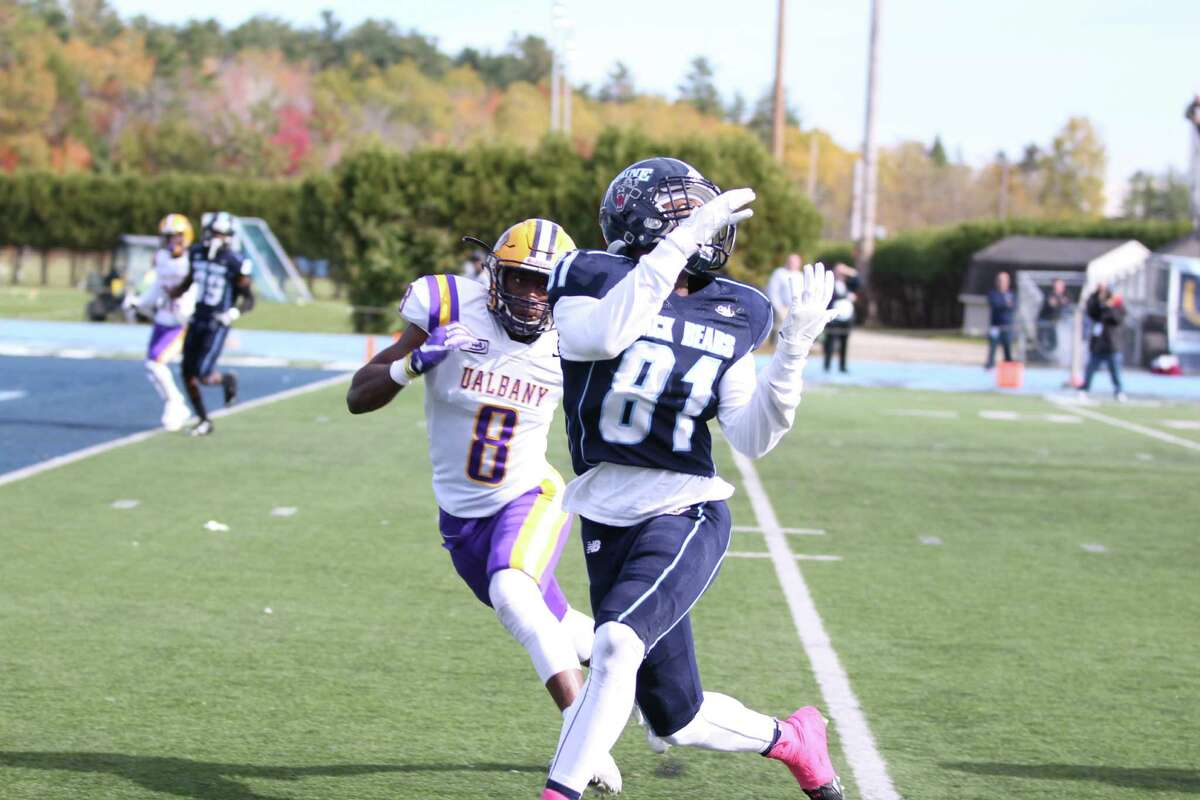 Maine's Earnest Edwards eyes a pass as UAlbany's Mason Gray defends in their game at Alfond Stadium in Orono, Maine, on Saturday, Oct. 15, 2016. (Mo Karim / UMaine Athletics)