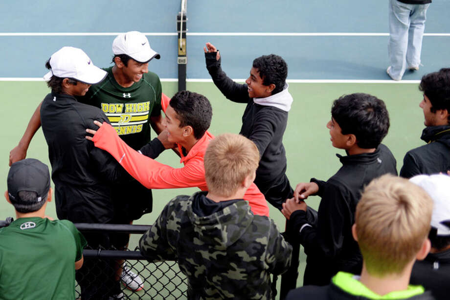 NICK KING | nking@mdn.net  Dow High's Varun Shanker, second from left, celebrates with teammates after winning his No. 1 singles final at the Division 2 state tennis finals Saturday at Hope College. / Midland Daily News